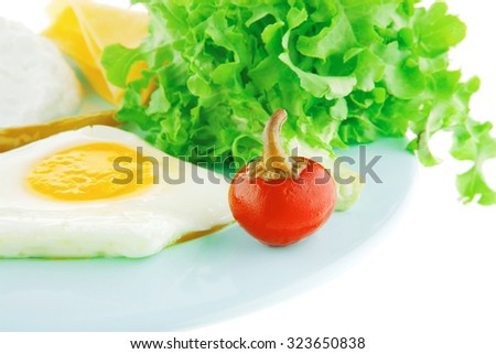 fried eggs and soft cottage cheese on blue - stock photo