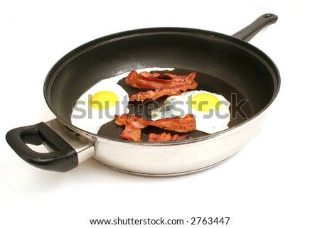 fried eggs & bacon in skillet - stock photo