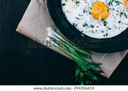 Fried eggs in cast iron frying pan - stock photo