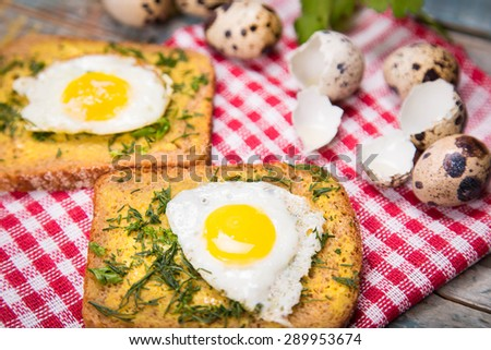 fried eggs on wooden plate with bread,oil in studio - stock photo