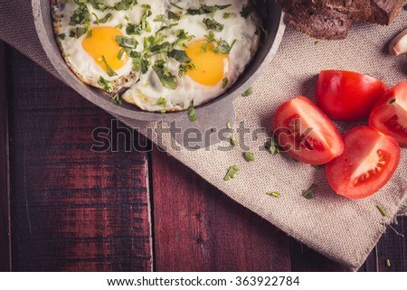 Fried eggs on wooden table