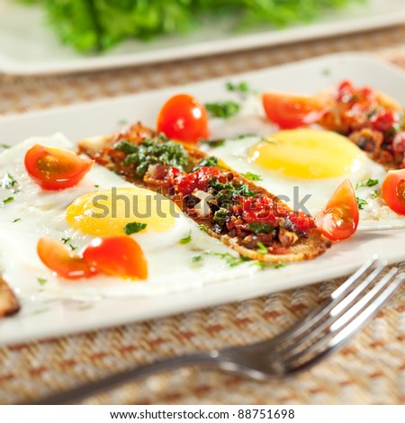Fried Eggs with Cherry Tomato, Toast with Pesto Sauce and Bacon - stock photo