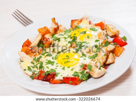 fried eggs with chicken breast, pepper and cheese - stock photo