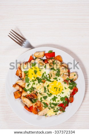 fried eggs with chicken breast, pepper and cheese