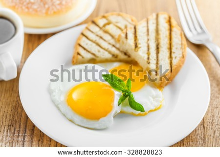 Fried eggs with coffee and dessert on breakfast. International cuisine.