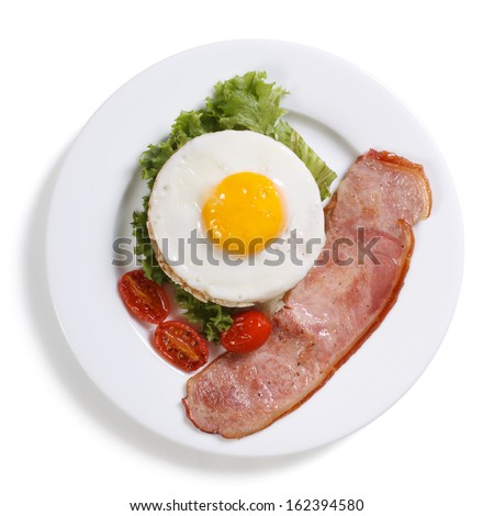 Fried eggs with vegetables and ham isolated on a white background top view. breakfast - stock photo