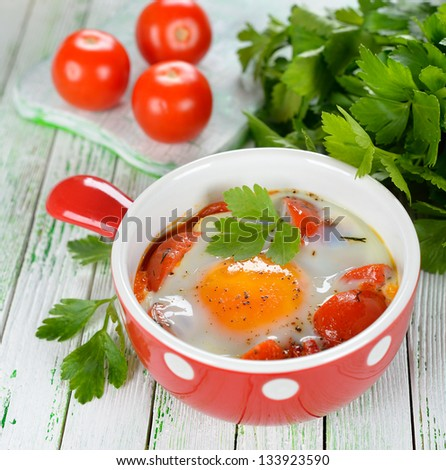 Fried eggs with vegetables on a white table
