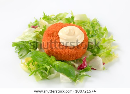 Fried ermine cheese with fresh salad - stock photo