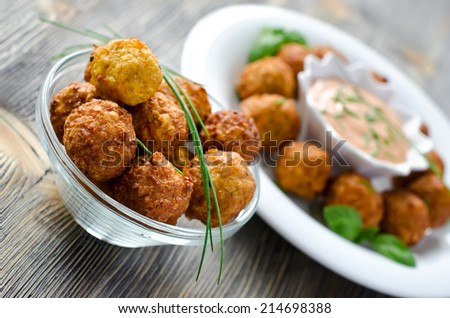 Fried falafels with a dip on wooden background selective focus - stock photo