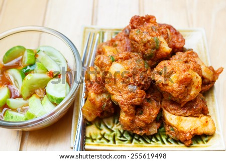 Fried fish cake with squid (Tod Mun), a favorite appetizer from Thailand. - stock photo