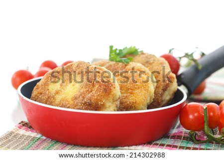 fried fish cutlets in the corn flour on a white background - stock photo