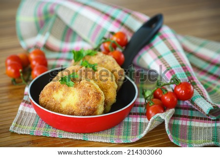 fried fish cutlets in the corn flour on the table - stock photo