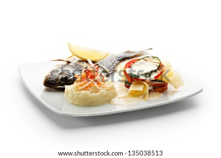 Fried Fish (Dorado). Garnished with Lemon,  Cream Cheese and Vegetables