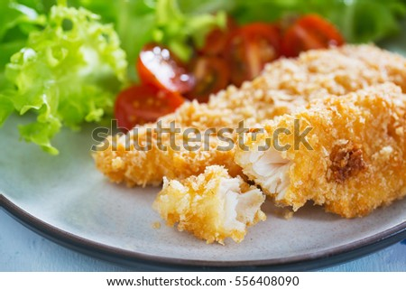 fried fish fillet with bread crumb and vegetable