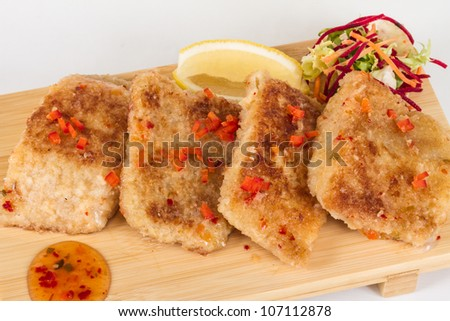 Fried fish fillets with  salad.