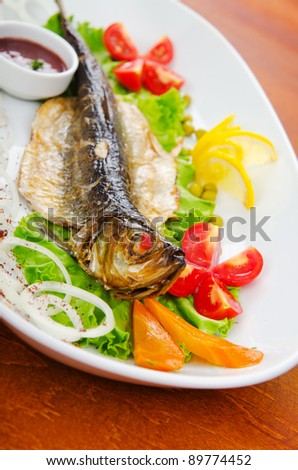 Fried fish in the plate
