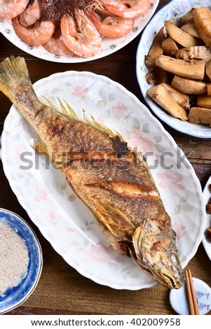 Fried fish on a plate - stock photo
