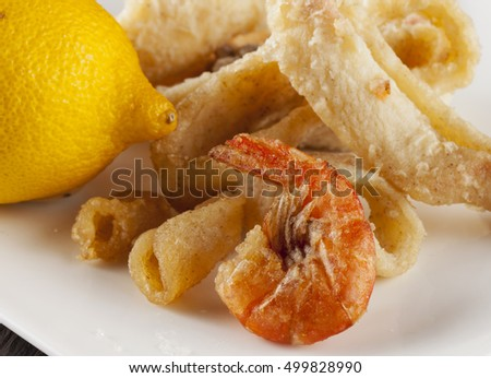 Fried fish over white plate, horizontal image