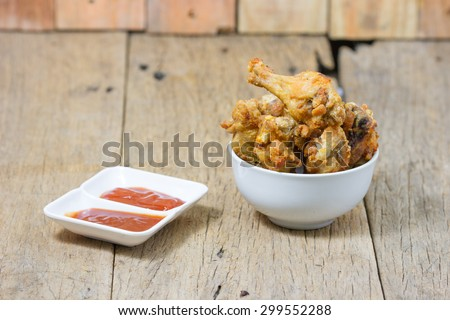 Fried fish sauce marinated chicken drumstick and sauce  - stock photo