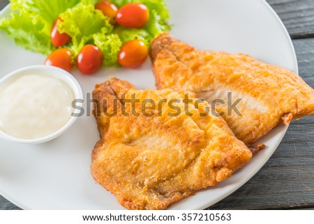 fried fish steak on wood background