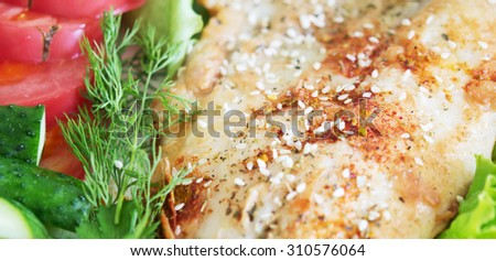 fried fish with spice and vegetables - stock photo
