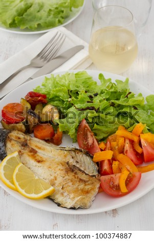 fried fish with vegetables and salad