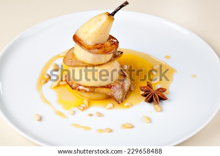 Fried foie gras with pear and sauce - stock photo