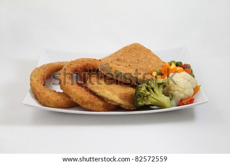 fried food with vegetables on white plate isolated on white background - stock photo