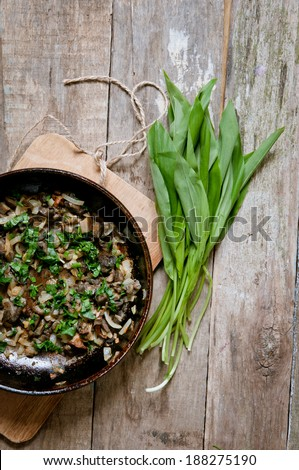 Fried forest mushrooms and wild garlic