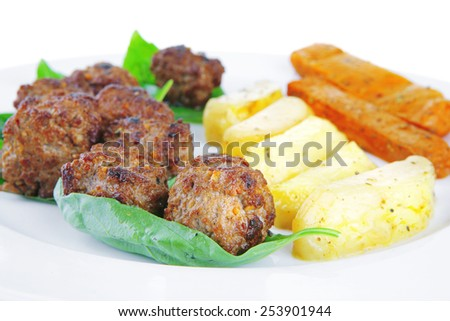 fried french cutlets with potatoes and basil - stock photo