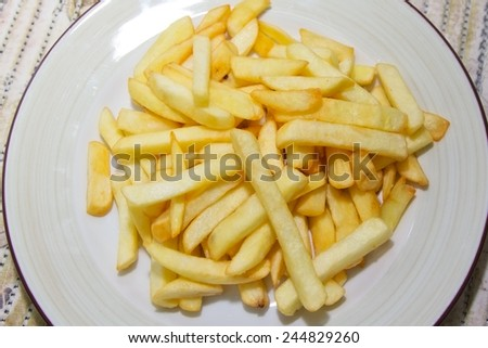 fried french fries on a plate - stock photo