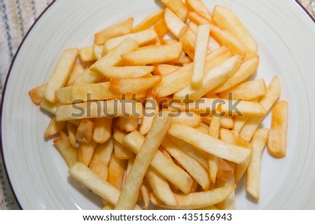 fried french fries on a plate