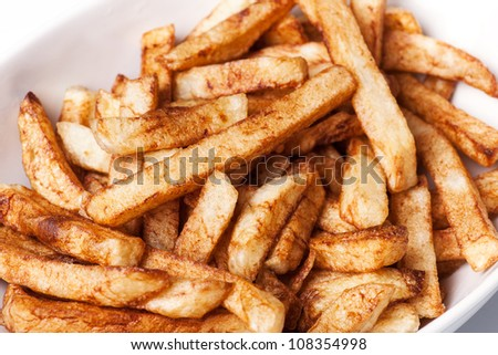 Fried french fries potatoes close up - stock photo