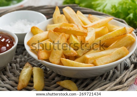 fried french fries with tomato sauce, close-up, horizontal - stock photo