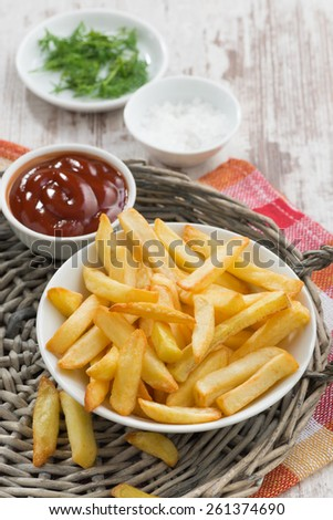 fried french fries with tomato sauce, vertical, top view - stock photo