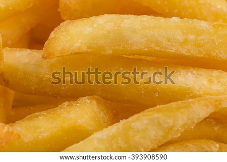 Fried french fry potatoes closeup for background - stock photo