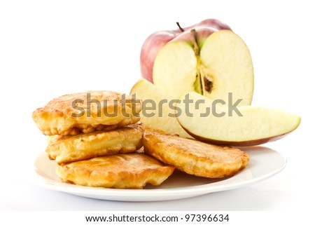 fried fritters on a white plate on white background - stock photo
