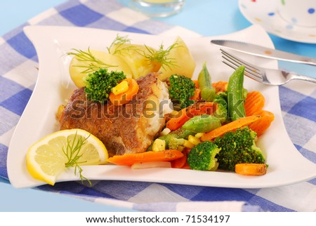 fried halibut fish with vegetables and potato for dinner