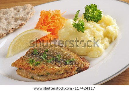 Fried herring with mashed potatoes and grated carrots, Swedish traditional delicacy also called strommingsflundra or herring flounder.