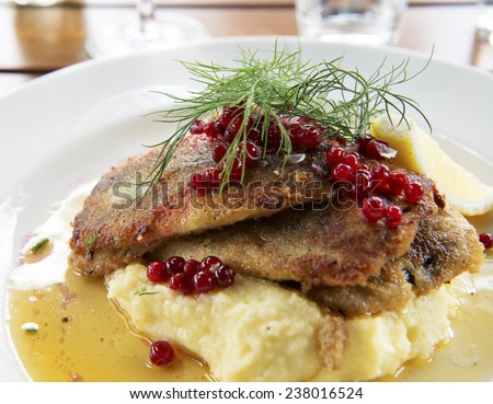 Fried herring with mashed potatoes, Swedish traditional delicacy also called strommingsflundra or herring flounder.  - stock photo