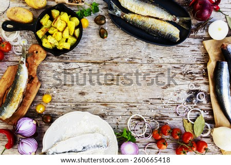 Fried herring with potatoes, Swedish traditional delicacy: strommingsflundra, herring flounder. - stock photo