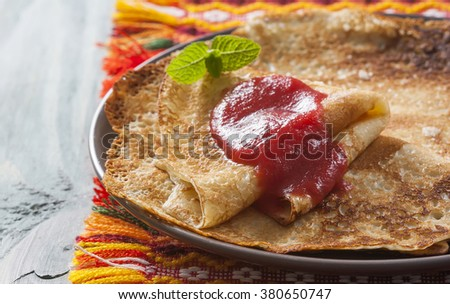 Fried homemade pancakes, traditional Russian meal. Selective focus