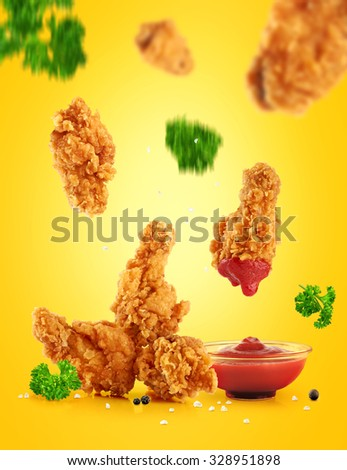 Fried in batter chicken wings and ketchup.  - stock photo