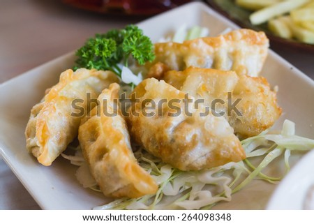 Fried Jiaozi with dipping sauces - stock photo