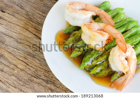 Fried King Prawns Asian Look  shrimp with asparagus in plate white color - stock photo