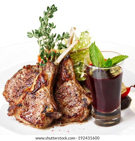 Fried lamb rack with vegetable garnish. Lamb chop dinner. - stock photo