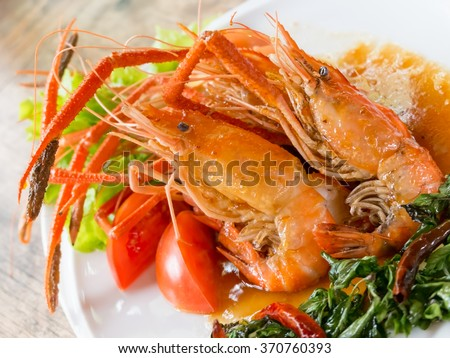 Fried lobster dinner with sauce on dish