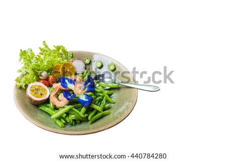 Fried long beans with prawns topping with Pea flowers , slices of orange and passion fruit on white background - stock photo