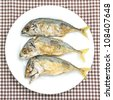 fried mackerel fishes on white plate - stock photo