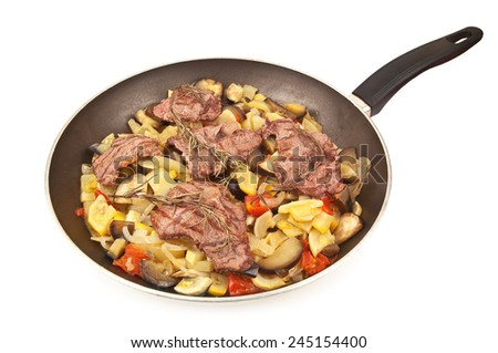fried meat and zucchini in pan - stock photo